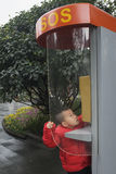 Kid calling sos Stock Image