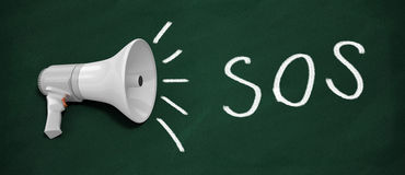 SOS. 3d rendered megaphone. SOS written on blackboard with Megaphone Stock Image