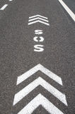 SOS emergency freeway lane. SOS sign with direction arrows on an emergency lane of a freeway royalty free stock images