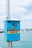 SOS, Emergency SOS telephone. Emergency SOS Telephone seaside, thailand royalty free stock photos
