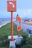 Sos and emergency telephone on highway in the evening time. Emergency telephone on highway in the evening time stock image