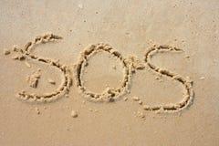 SOS en la arena Imagenes de archivo