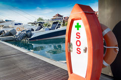 SOS first aid kit, on Marina Harbor. Close up Stock Photos