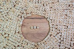 SOS, German text for distress signal, word in letters on cube dices on table.  stock photography