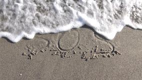 SOS Help Cry For Help Written On Beach Sand Washed Away By Ocean Waves. Inscription of `SOS`. SOS Help Cry For Help Written On Beach Sand Washed Away By Ocean stock video footage