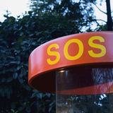 Sos. Letters sos on roof of hut for give an alert Stock Photos
