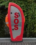 SOS Lifebelt station. Near river Stock Photos