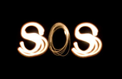 SOS_light_painting. Light painting photograph of the distress signal SOS Royalty Free Stock Image