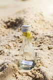 SOS message in glass bottle. On the beach royalty free stock photo