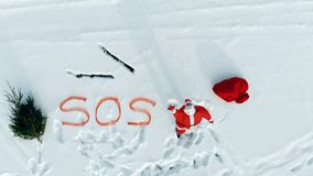 SOS-message of Santa Claus in the snowy open space. 4K stock images