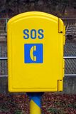 SOS phone box. Bright yellow SOS phone box Royalty Free Stock Photo