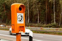 SOS phone. Emergency telephone at the roadside. Morning on the German highway. Stock Photos