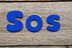 SOS słowo Obrazy Royalty Free