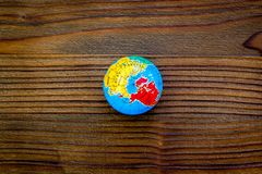 SOS Save the planet concept with the earth on dark wooden background flat lay moke-up. SOS Save the planet concept with the earth on dark wooden background top royalty free stock photo