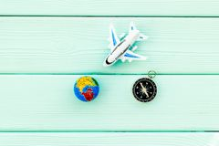 SOS Save the planet concept with the earth, plane and compass on blue wooden background flat lay. SOS Save the planet and eco concept with the earth, plane and stock image