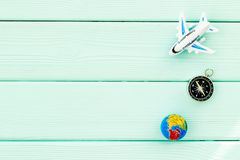 SOS Save the planet concept with the earth, plane and compass on blue wooden background flat lay mockup. SOS Save the planet and eco concept with the earth stock photos