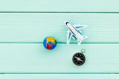 SOS Save the planet concept with the earth, plane and compass on blue wooden background flat lay mockup. SOS Save the planet and eco concept with the earth stock image