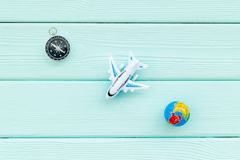 SOS Save the planet concept with the earth, plane and compass on blue wooden background flat lay mockup. SOS Save the planet and eco concept with the earth stock images