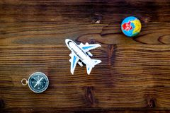 SOS Save the planet concept with the earth, plane and compass on wooden background flat lay mock-up. SOS Save the planet and eco concept with the earth, plane royalty free stock photo