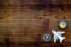 SOS Save the planet concept with the earth, plane and compass on wooden background flat lay mock-up. SOS Save the planet and eco concept with the earth, plane stock photo