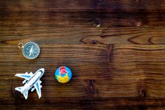SOS Save the planet concept with the earth, plane and compass on wooden background flat lay mock-up. SOS Save the planet and eco concept with the earth, plane stock images