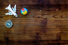 SOS Save the planet concept with the earth, plane and compass on wooden background flat lay mock-up. SOS Save the planet and eco concept with the earth, plane royalty free stock photography