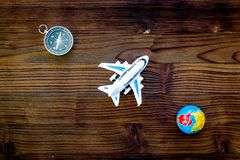 SOS Save the planet concept with the earth, plane and compass on wooden background flat lay mock-up. SOS Save the planet and eco concept with the earth, plane royalty free stock image