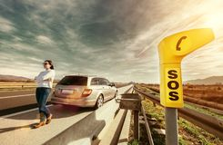 SOS service point on highway. Woman driver has a problem with car Royalty Free Stock Photos