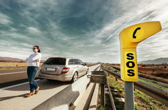 SOS service point on highway. Woman driver has a problem with car Stock Photography