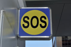 SOS sign. Metallic SOS sign in the street. Aid concept Stock Photo