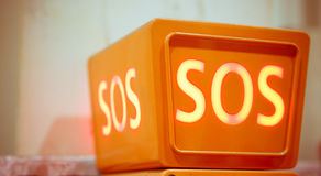 Sos sign, closeup view. Orange sos sign, closeup view Stock Photo