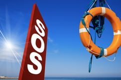 SOS Sign Lifebuoy Sea and Blue Sky stock image