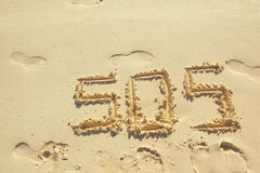 SOS. Sign made on sand in the beach Royalty Free Stock Image