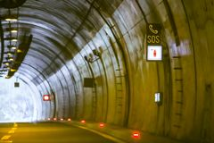Sos sign in the tunnel. On highway with exit of the tunnel in the background royalty free stock photo