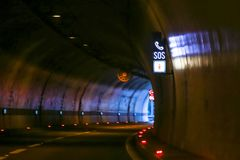 Sos sign in the tunnel. On highway with exit of the tunnel in the background royalty free stock images