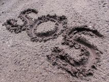SOS sign written on the ground stock photos