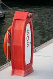 SOS stand. Emergency SOS stand in yacht club stock photography