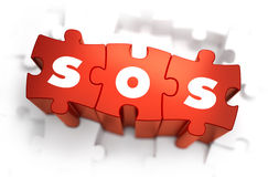 SOS - Text on Red Puzzles Stock Photography