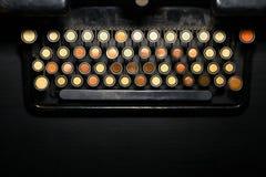 SOS typewriter metaphor. Color close up of a typewriter keyboard, having the word 'SOS' written on it Stock Image