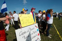 SOS Venezuela Protest. Doral, Miami / United States - February 22 2014: Protestors gather at a rally in Doral, Miami, to raise concerns about the worsening stock image