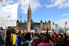 SOS Venezuela protest in Ottawa. Venezuelans gather in front of Parliament Hill to bring attention to the plight of their countrymen who are protesting against Royalty Free Stock Photo