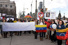 SOS Venezuela protest in Ottawa. Venezuelans gather in front of Parliament Hill to bring attention to the plight of their countrymen who are protesting against Royalty Free Stock Image