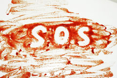 SOS on white background. Bloody red word SOS on white background Royalty Free Stock Image