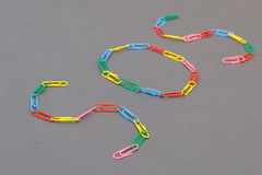 Sos word made of paper clips. Isolated Royalty Free Stock Image