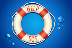 SOS written on Lifebouy Royalty Free Stock Image