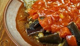 Soslu patlican. Turkish cuisine, Tomato sauce with eggplant Stock Photo