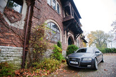 Sosnowiec, Poland - October 23, 2014: Audi S6 (Audi A6),  car pr. Oduced by German automaker Audi background old mansion Stock Photo