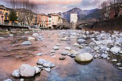 Sospel at Sunset. River Bevera and the bridge. Provence. A village in the South of France called Sospel. Mountains in the background. River Bevera stock photography