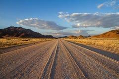 The Sossusvlei dirt road, Namibia. A dirt road in the Sossusvlai desert, Namibia Stock Photo