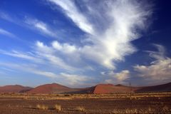 Sossusvlei Dune National park. Sossusvlei on a sunny blue sky day where the red iron oxide dunes are static royalty free stock image